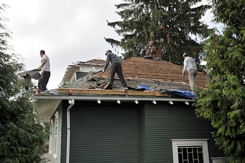 roof-repair-crew-tearing-off-and-reroofing